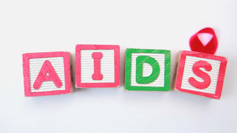 Aids spelled out in blocks with red ribbon Footage