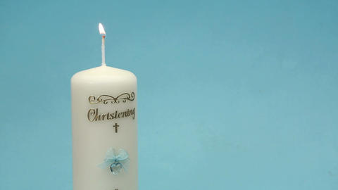 Hand lighting christening candle Footage