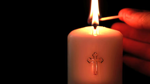 Candle with cross embellishment Footage