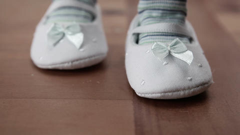 Baby wearing booties first steps Footage