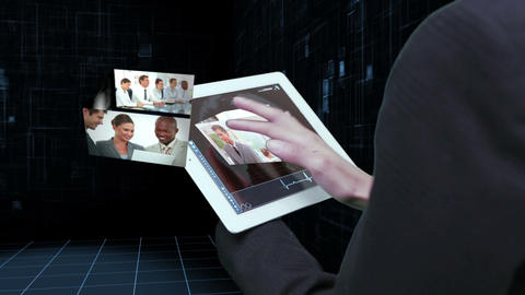 Businesswoman using tablet to view montage of busi Animation
