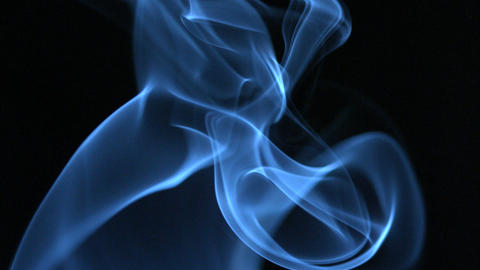 Blue smoke rising on black background Footage
