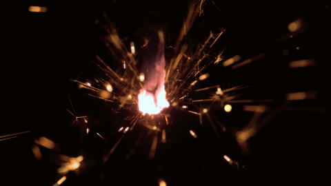Burning sparkler close up Live Action