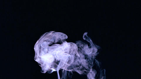 Rising puff of smoke on black background Footage