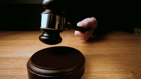 Judge hammering gavel onto sounding block Footage