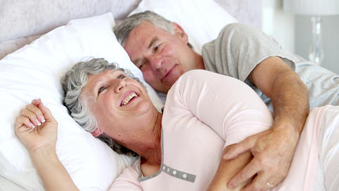 Couple talking and laughing in the bed Footage