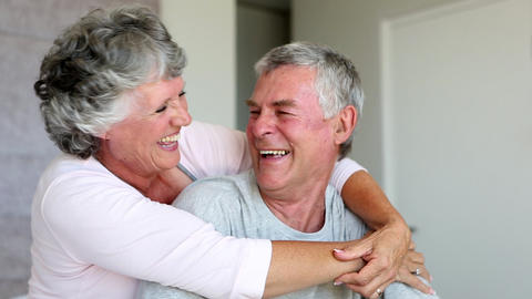 Mature couple laughing and embracing together Footage
