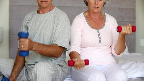 Mature couple doing exercises Footage