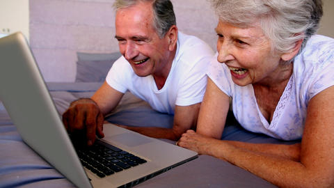 Elderly couple using laptop together Footage