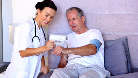 Home Nurse Pleased With Patients Blood Pressure stock footage