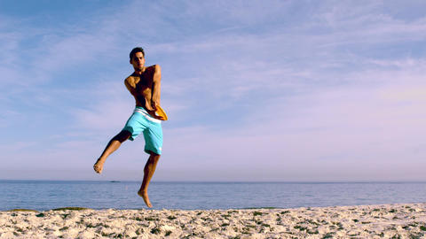 Attractive man catching a frisbee Footage