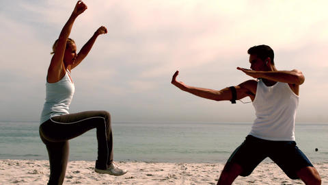 Athletes doing martial arts on the beach Footage