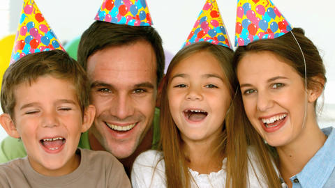 Portrait of smiling family with party hats Footage