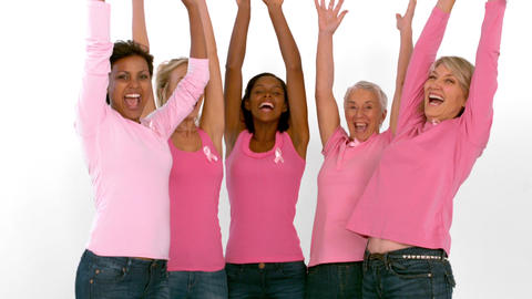 Group of cheerful women raising arms for breast ca Footage