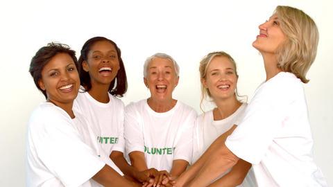 Volunteers raising hands together Footage