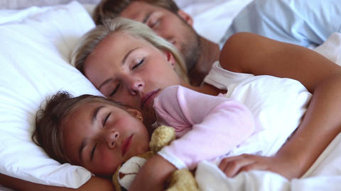 Parents and daughter sleeping peacefully Footage
