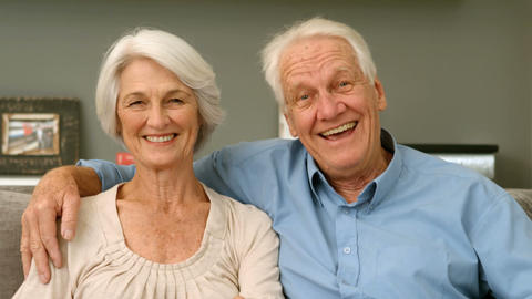 Elderly couple smiling and looking to the camera Footage