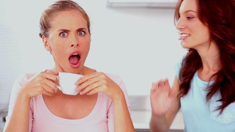 Woman telling her friend a secret Footage