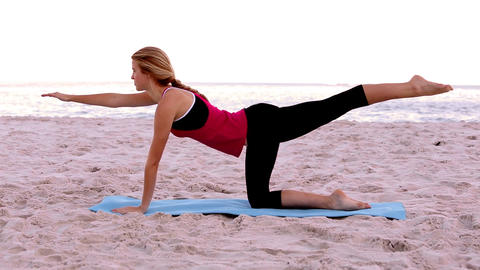 Blonde woman doing pilates stretches Footage