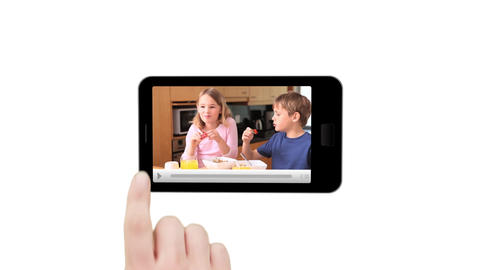Hand using smartphone screen to press play family clip Animation