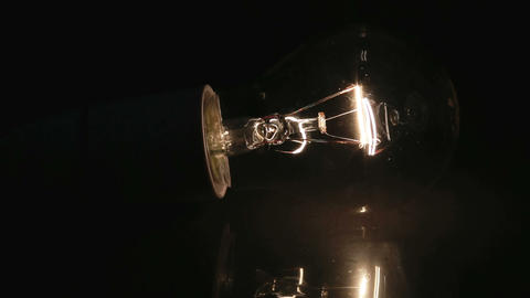 Shining light bulb on its side and switching off Footage