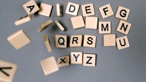 Plastic letters bouncing and showing the alphabet Footage