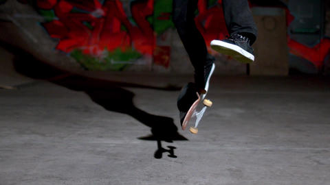 Front view of skater doing 360 flip Footage