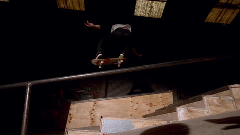 Skater doing large ollie down steps low angle view Footage