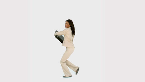Businesswoman jumping and holding her suitcase Footage