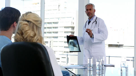 Medical team looking at xray Footage
