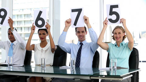 Business people showing scores Footage