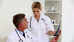 Doctors examining xray Footage