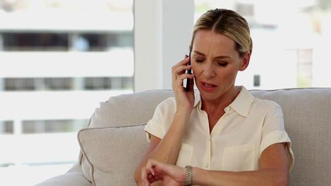 Blonde businesswoman on the phone ライブ動画
