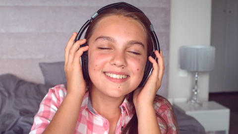 Girl listening to music with headphone Footage