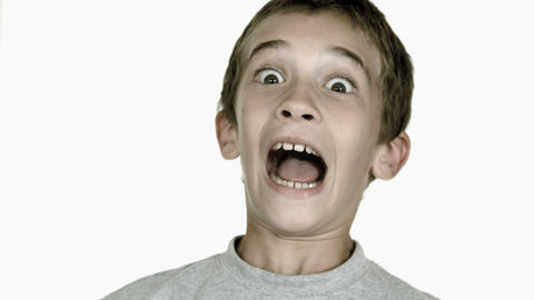 Boy grimacing against white background Footage
