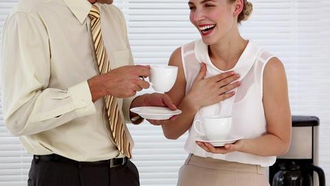 Business people flirting during their break Footage