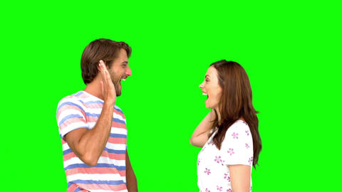Friends giving highfive on green screen Footage