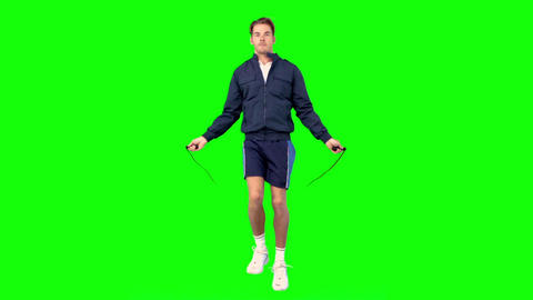 Young man training with a skipping rope Footage