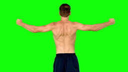 Shirtless man showing his muscles Footage