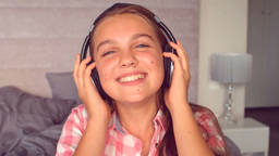 Girl listening to music with headphones Footage