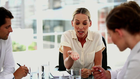Irritated businesswoman giving out to colleagues Footage