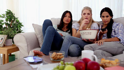 Friends eating popcorn while watching a movie Footage