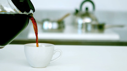 Coffee being poured into cup of coffee Footage