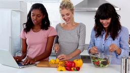 Friends following an online recipe Footage
