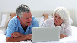 Mature Couple Using Laptop Together stock footage