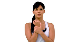 Fit woman massaging her wrist Footage