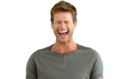 Handsome man laughing on white background Live Action