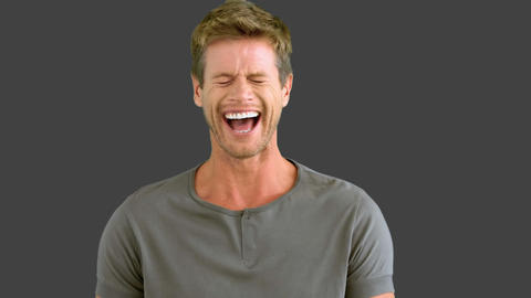 Man laughing on grey screen Live Action