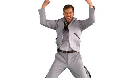 Excited businessman jumping and cheering on white background Footage