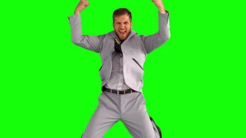 Businessman cheering and jumping Footage